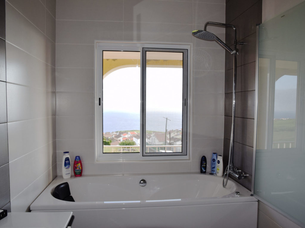 Bathroom including bathtub with integrated whirlpool and views of the Atlantic