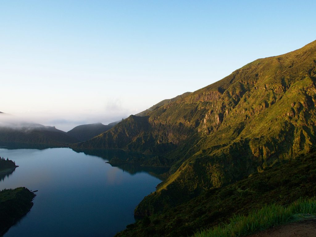 The warm sunlight chases away the chill of the night at the Lagoa do Fogo.