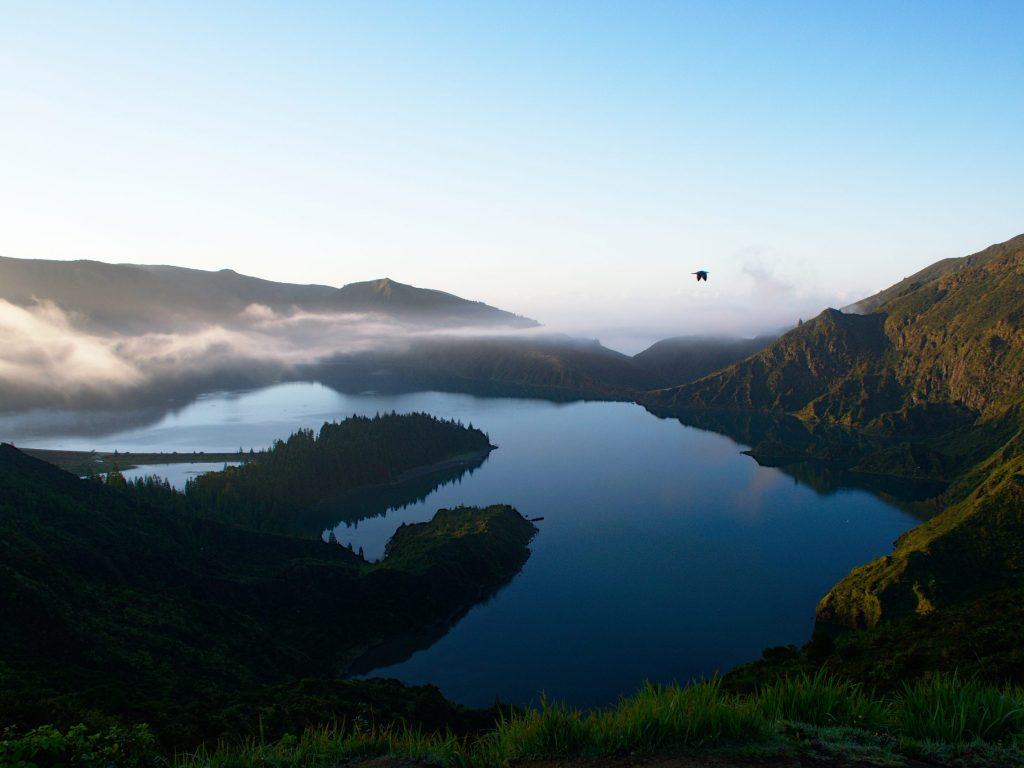 Reflection in the Lagoa do Fogo during the sunrise