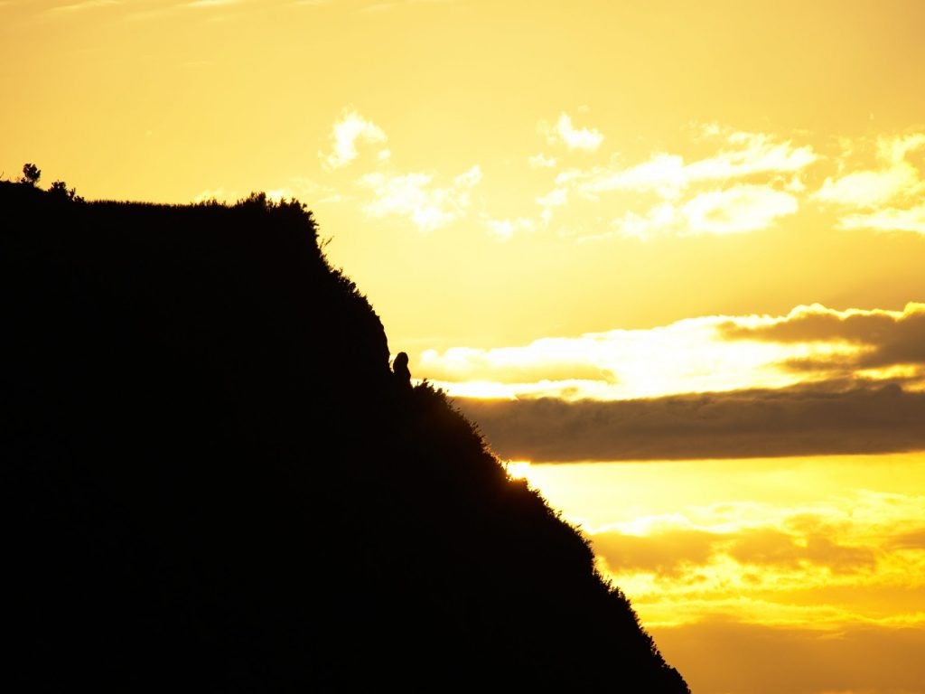 The mysterious figure in the sunset at the Miradouro do Parque Endémico do Pelado