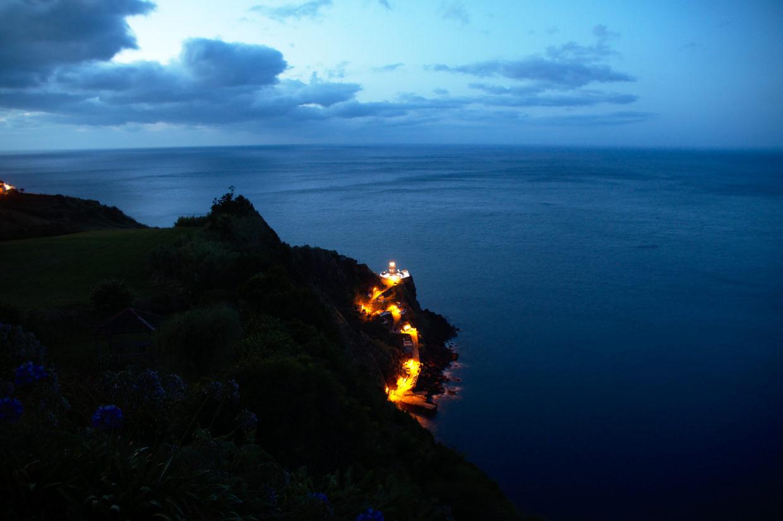 Farol Ponta do Arnel and the port by night