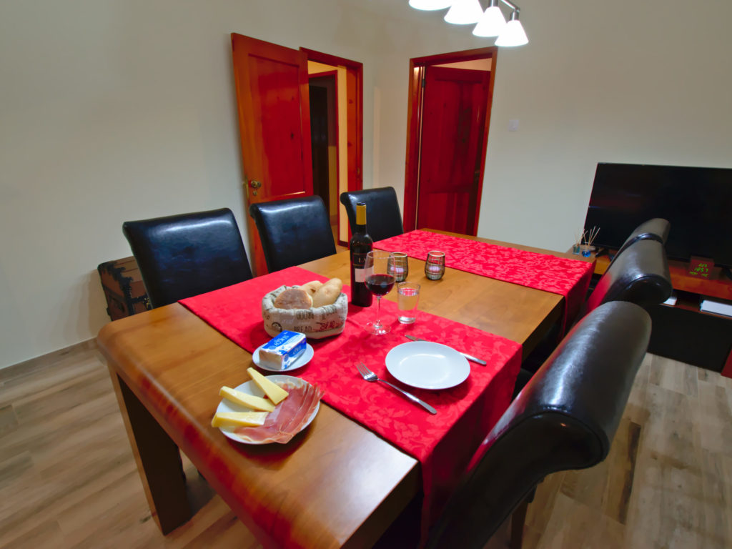 Dining table in the living room with food